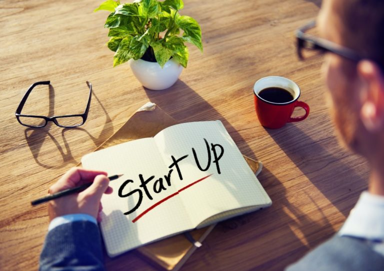 "notebook with ""Start Up"" text"