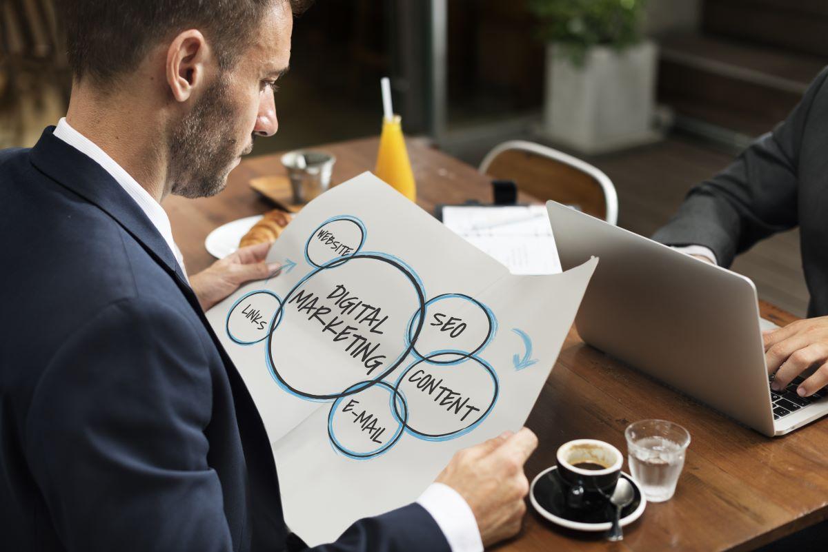 man looking at marketing plan draft