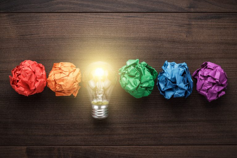 lightbulb next to crumpled paper balls